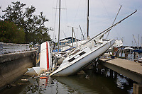 Sailboats and pleasure boats that were ravaged by Hurricane Katrina are left stacked on top of each other in the Lake Pontchartrain municipal marina and yacht harbor in New Orleans, Louisiana.