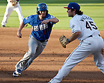 Las Vegas 51s runner Mike McCoy heads back to the bag as Reno Aces frist basemen Ryan Wheeler takes the throw during their game on Monday night July 2, 2012 at Aces Ballpark in Reno, NV.