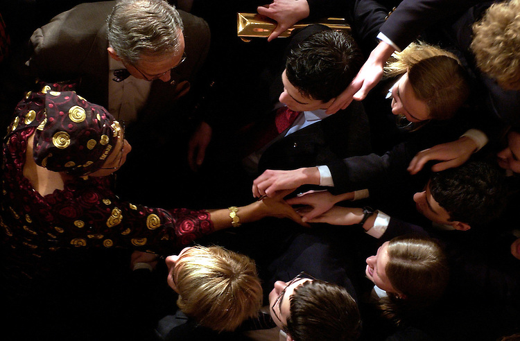 Ellen Johnson Sirleaf, president of the Republic of Liberia, greets pages in the House Chamber after she addressed a joint session of Congress.