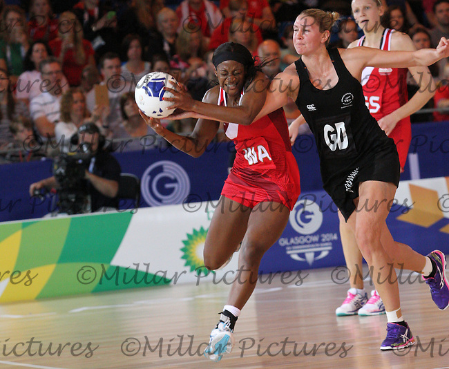 Liana Leota of Team England being challenged by Katrina Grant in the Team New Zealand against Team England in the Netball Semi Final for the 20th Commonwealth Games, Glasgow 2014 at the Scottish Exhibition and Conference Centre, Glasgow on 2.8.14.