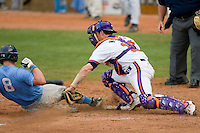 John Nester #17 of the Clemson Tigers tags out Mark Fleury #8 of the North Carolina Tar Heels as he tries to score in the 10th inning at Durham Bulls Athletic Park May 23, 2009 in Durham, North Carolina. The Tigers defeated the Tar Heals 4-3 in 11 innings.  (Photo by Brian Westerholt / Four Seam Images)