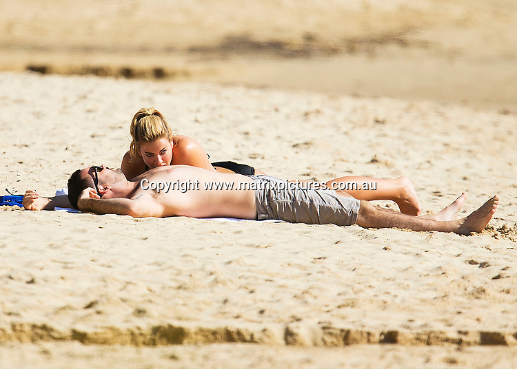 18 APRIL 2016 SYDNEY AUSTRALIA<br /> WWW.MATRIXPICTURES.COM.AU<br /> <br /> EXCLUSIVE PICTURES<br /> <br /> Fiona Falkiner pictured with her new boyfriend on the northern beaches enjoying some al fresco frolicking. Fiona and her Tinder date spent the afternoon on the beach together with Fiona at one point giving her beau a good old fashioned nipple suck. Its wasn't long before their passions got the better of them and they paddled across Pittwater to a secluded beach where Fiona's new stallion mounted his stead for some public copulation.