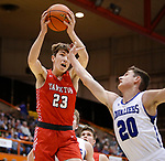 February 28, 2020; Yankton at St. Thomas More High School Basketball -- Jaden Kral #23 of Yankton grabs a rebound in front of St. Thomas More player Connor Hollenbeck #20 during their game Friday evening at Barnett Arena in Rapid City, S.D.(Photo by Richard Carlson/Inertia)