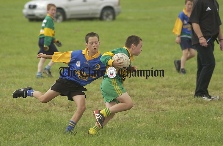 Action from the Michael Cusack's versus Kilfenora football game at the Burren Festival in Carron. Photograph by John Kelly.