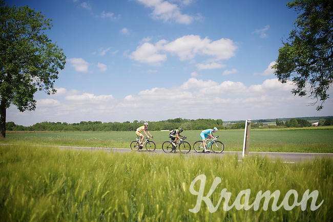 breakaway group: Sebastien Delfosse (BEL/Wallonie-Bruxelles), Serge Dewortelaer (BEL/Veranclassic-Doltcini) &amp; Evan Huffman (USA/Astana) racing through the sunny fields<br /> <br /> 2014 Belgium Tour<br /> stage 4: Lacs de l'Eau d'Heure - Lacs de l'Eau d'Heure (178km)