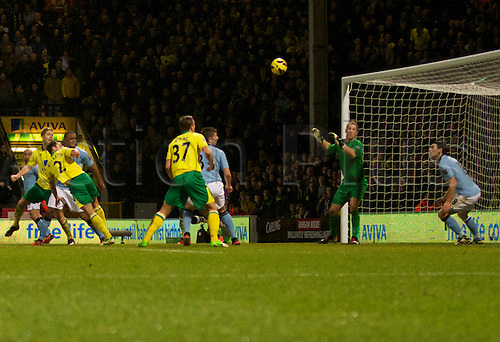 29.12.2012 Norwich, England. Russell Martin scores during the Premier League game between Norwich and Manchester City from Carrow Road.