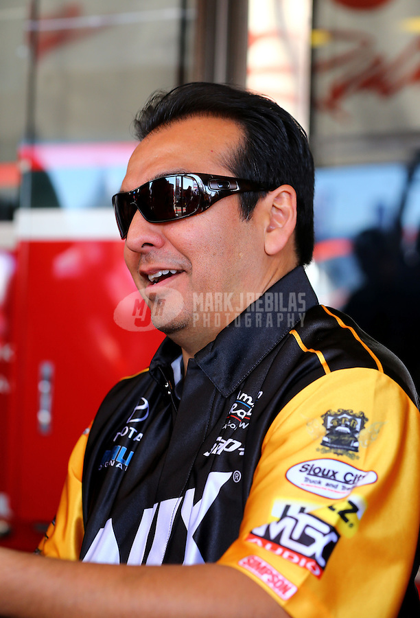 Nov 8, 2013; Pomona, CA, USA; NHRA funny car driver Tony Pedregon during qualifying for the Auto Club Finals at Auto Club Raceway at Pomona. Mandatory Credit: Mark J. Rebilas-