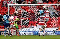 Aaron Pierre of Wycombe Wanderers (2nd right) clears off the line under pressure from Riccardo Calder of Doncaster Rovers (right) during the Sky Bet League 2 match between Doncaster Rovers and Wycombe Wanderers at the Keepmoat Stadium, Doncaster, England on 29 October 2016. Photo by David Horn.