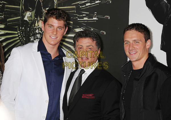 """Conor Dwyer, Sylvester Stallone, Ryan Lochte.""""The Expendables 2"""" Los Angeles Premiere held at Grauman's Chinese Theatre, Los Angeles, California, USA..August 15th, 2012.half length blue white shirt black suit .CAP/ROT/TM.©Tony Michaels/Roth Stock/Capital Pictures"""