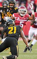 NWA Democrat-Gazette/CHARLIE KAIJO Arkansas Razorbacks wide receiver Brandon Martin (5) runs the ball during a football game on Friday, November 24, 2017 at Razorback Stadium in Fayetteville.