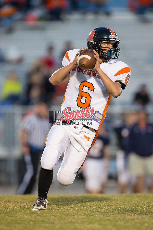 Chris Monteleone (6) of the Northwest Cabarrus Trojans rolls out looking to pass the football during first half action against the Carson Cougars at Jesse Carson High School on October 24, 2014, in China Grove, North Carolina.  The Cougars defeated the Trojans 35-6.  (Brian Westerholt/Sports On Film)