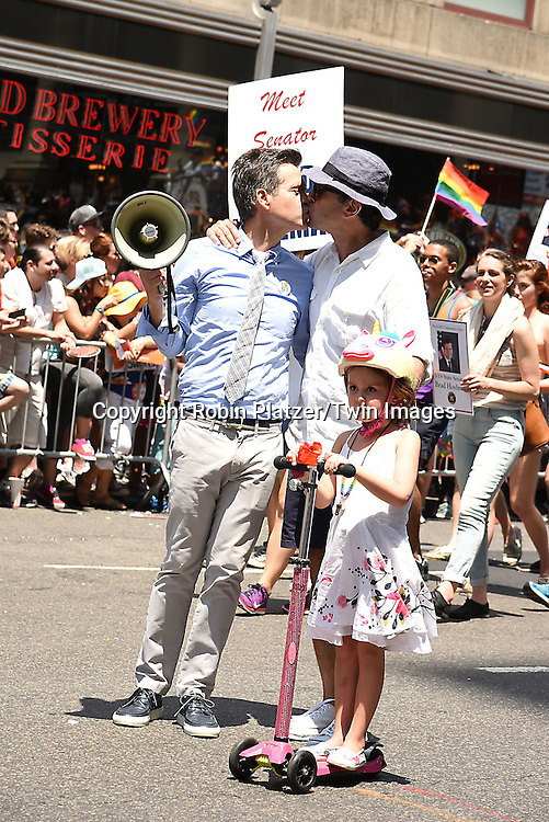 State Senator Brad Hoylman and husband DAvid Sigal and daughter Silvia attends the New York City Gay Pride March 2016 on June 26, 2016 on Fifth Avenue in New York City, New York, USA.<br /> <br /> photo by Robin Platzer/Twin Images<br />  <br /> phone number 212-935-0770