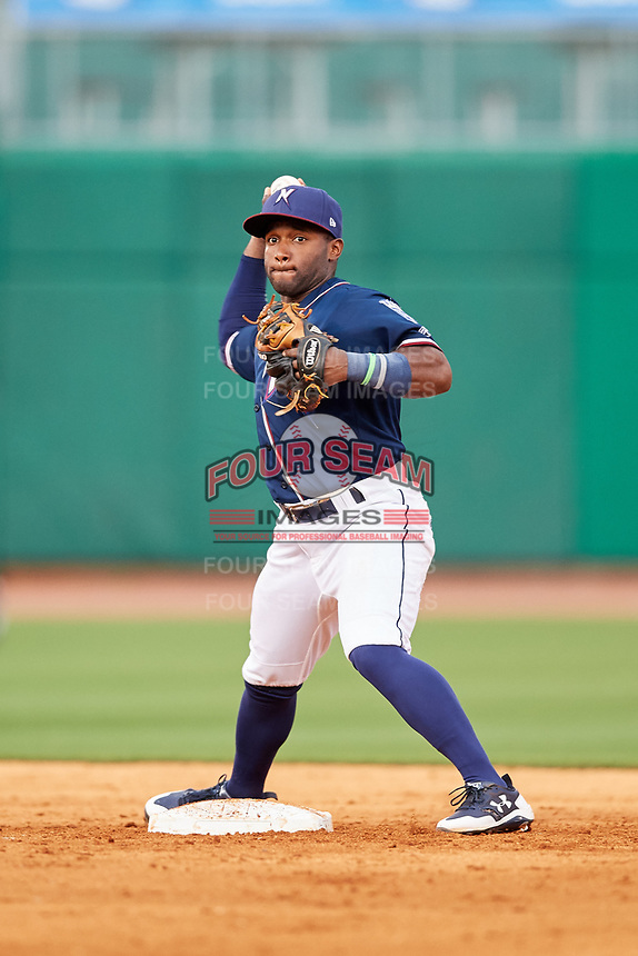 Northwest Arkansas Naturals second baseman Ruben Sosa (4) throws to first base during a game against the Midland RockHounds on May 27, 2017 at Arvest Ballpark in Springdale, Arkansas.  NW Arkansas defeated Midland 3-2.  (Mike Janes/Four Seam Images)