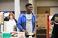 NWA Democrat-Gazette/JASON IVESTER<br /> Emmanuel (cq) Onyebueke (cq), junior, talks with fellow students on his display of Nigeria, his native country, Thursday, April 20, 2017, during an international festival at Bentonville West High School in Centerton. Students in foreign language classes at the school researched approximately 30 countries for the display.