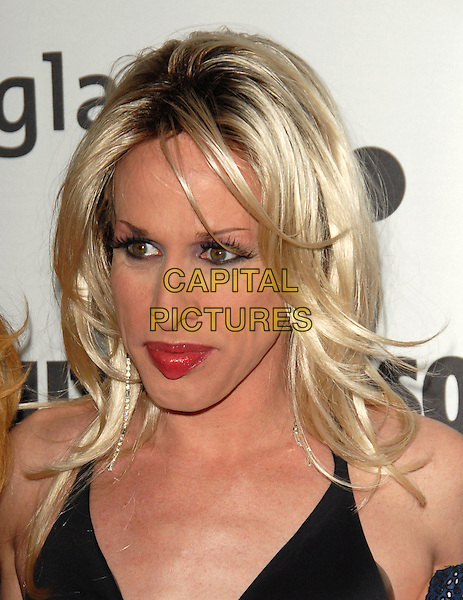 ALEXIS ARQUETTE .Attends The 17th Annual GLAAD Media Awards held at The Kodak Theatre in Hollywood, California, USA, .April 8th 2006..portrait headshot drag .Ref: DVS.www.capitalpictures.com.sales@capitalpictures.com.©Debbie VanStory/Capital Pictures