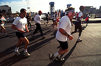 (020108-SWR13.jpg) New York, NY -  Athletes run through the Mott Haven section of the Bronx during the New York City Marathon. The 26 mile long distance race runs through all five boroughs of the city.