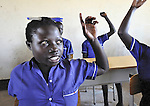 A girl raises her hand during class in a school in the Southern Sudanese village of Kenyi. The school was constructed by the United Methodist Committee on Relief (UMCOR).  Families here are rebuilding their lives after returning from refuge in Uganda in 2006 following the 2005 Comprehensive Peace Agreement between the north and south. NOTE: In July 2011, Southern Sudan became the independent country of South Sudan