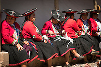 Local Quechua women in traditional dress at Chinchero Town Sunday Market, Peru, South America