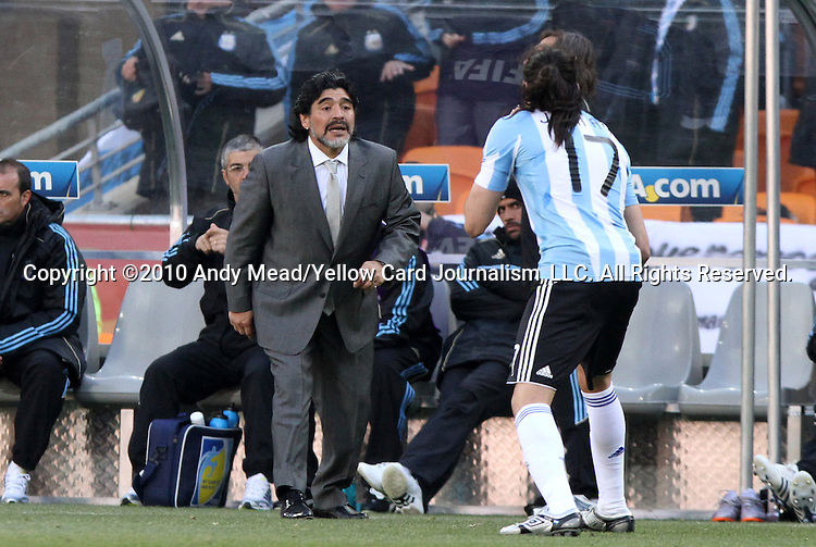 17 JUN 2010: Argentina head coach Diego Maradona (ARG) talks to Jonas Gutierrez (ARG) (17). The Argentina National Team defeated the South Korea National Team 4-1 at Soccer City Stadium in Johannesburg, South Africa in a 2010 FIFA World Cup Group E match.