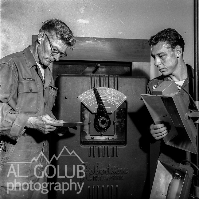 Base Photo lab<br /> <br /> March 1964: CAFB, California<br /> Staff of the Valley Bomber, 93rd Bomb Wing, Directory of Information, SAC<br /> Photo by Al Golub/Golub Photography<br /> <br /> Castle is named for Brigadier General Frederick W. Castle, who died on Dec. 24, 1944 flying his 30th bombing mission. He died leading an armada of 2000 B-17s on a strike against German airfields. On the way to the target, an engine failure over Liege, Belgium caused his bomber to fall behind, where it was attacked by Germans and caught fire. He ordered his men to bail out but stayed alone at the controls of the flaming Flying Fortress until it crashed. The entire crew, except Gen. Castle and one airman killed before the bailout order, survived. Gen. Castle received a Medal of Honor posthumously for his bravery.<br /> <br /> Castle became home to the 93rd Bombardment Wing in 1947. Aircraft stationed at Castle included B-29, B-17 and C-54 aircraft, with B-50 bombers arriving in 1949. In 1954, B-47 bombers arrived.  On June 29, 1955, Castle received the Air Force's first B-52. These heavy bombers can hold the equivalent of three railroad cars' worth of fuel. The first Air Force KC-135 jet tanker arrived May 18, 1957<br /> <br /> Castle was selected for closure under the Defense Base Closure and Realignment Act of 1990 during Round II Base Closure Commission deliberations (BRAC 91). The last of the B-52s left the base in 1994, followed by the departure of the last of the KC-135s in early 1995. The base closed September 30, 1995.