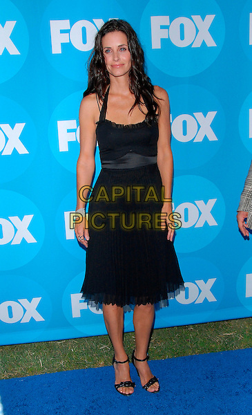 COURTENEY COX ARQUETTE .attends The FOX Network TCA Party held at Ritz Carlton Huntington Hotel in the Horseshoe Garden in Pasadena, California, USA, July 25 , 2006..full length black dress halterneck sandals strappy shoes courtney.Ref: DVS.www.capitalpictures.com.sales@capitalpictures.com.©Debbie VanStory/Capital Pictures
