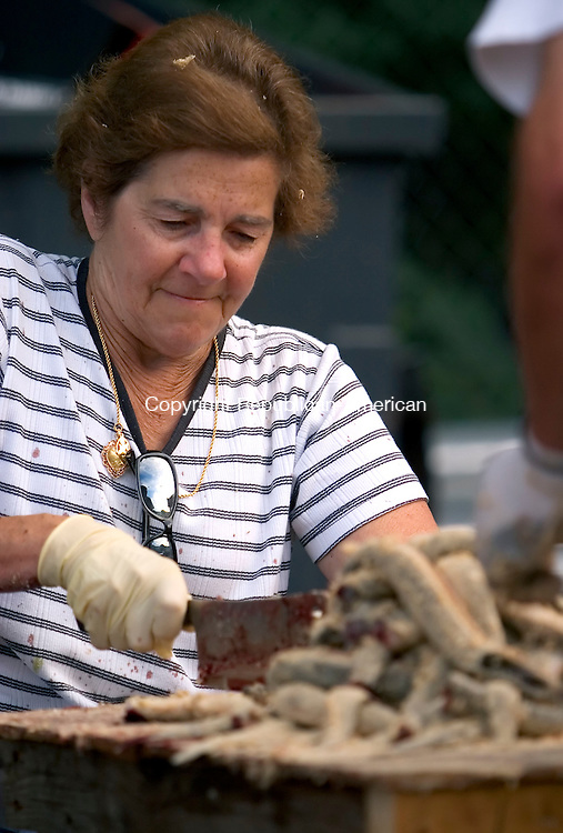 NAUGATUCK, CT - 26 AUGUST 2005 -082605JS03--Longtime volunteers Frances Branco, was among the many volunteers on hand to prepare eels on Friday in preperation for next weekends annual Sao Paio Festival at the Portguese Club in Naugatuck. --Jim Shannon / Republican-American  -- Frances Branco Naugatuck, Sao Paio Festival,  Portguese Club are CQ