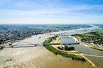Nederland, Gelderland, Nijmegen, 09-06-2016; de nieuw aangelegde nevengeul van de rivier de Waal, ontstaan door de dijkverlegging bij Lent, gezien naar de binnenstad van Nijmegen. Onderdeel van het project Ruimte voor de River (Ruimte voor de Waal). Rechts de ingang van de nevengeul met drempel.<br /> The finished dike relocation of Lent (project Ruimte voor de Rivier: Room for the River) with the resulting flood trench. Entrance to the secondary channel with the threshold. In the background the city of Nijmegen.<br /> luchtfoto (toeslag op standard tarieven);<br /> aerial photo (additional fee required);<br /> copyright foto/photo Siebe Swart