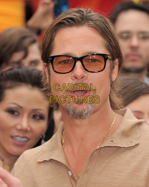 BRAD PITT .at The Dreamworks Animation L.A. Premiere of 'Kung Fu Panda 2' held at The Grauman's Chinese Theatre in Hollywood, California, USA,.May 22nd 2011..Portrait headshot beige brown top shirt beard goatee facial hair glasses tinted sunglasses  gold necklace mouth open                                                           .CAP/RKE/DVS.©DVS/RockinExposures/Capital Pictures.