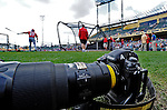 6 March 2012: Ed Wolfstein's camera rests ready for game as the Washington Nationals take batting practice prior to a Spring Training game against the Atlanta Braves at Champion Park in Disney's Wide World of Sports Complex, Orlando, Florida. The Nationals defeated the Braves 5-2 in Grapefruit League action. Mandatory Credit: Ed Wolfstein Photo