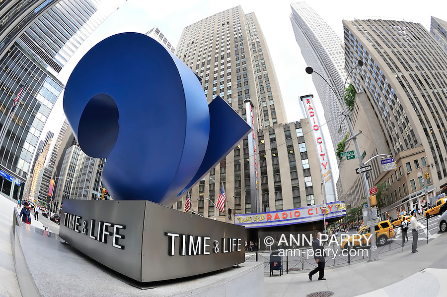 """Midtown Manhattan, New York City, landmarks and famous tourist attractions, seen through fisheye lens, on June 27, 2011. Radio City Music Hall and blue sculpture """"Cubed Curve"""" by William Crovello, in front of the Time & Life Building Plaza at 1271 Avenue Of The Americas (6th Avenue) in Rockefeller Center."""