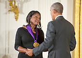United States President Barack Obama presents the 2015 National Medal of Arts to Audra McDonald, Actress & Singer of Croton-on-Hudson, New York, New York during a ceremony in the East Room of the White House in Washington, DC on Thursday, September 22, 2016.<br /> Credit: Ron Sachs / CNP
