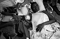 Port Au Prince, Haiti, Jan 23 2010.Naomi Estimat, 27, a mother of 2 has lost her right arm when a wall from her house collapsed on her. The Belgian B-Fast team has set up a field hospital in Delmas 33; 2 surgeons treat vicitms of hevy traumatisms..