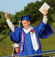 BENSALEM, PA - JUNE 18: Jeffrey Michael News Jr. raises his arms after receiving his diploma during Bensalem High School's 90th Annual Commencement ceremony June 18, 2014 at Bensalem Memorial Stadium in Bensalem, Pennsylvania. About 500 students graduated. (Photo by William Thomas Cain/Cain Images)