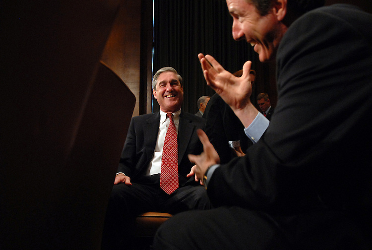 """Robert Mueller, director of the Federal Bureau of Investigation, center, has a word with Paul Martin of the Department of Justice, during a break in the Senate Judiciary Committee hearing on """"FBI Oversight."""""""