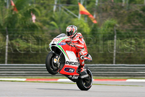 19.10.2012. Sepang, Malaysia.   Nicky Hayden of Ducati Team during the friday's free practice session for MotoGP class of  Malaysian Motorcycle Grand Prix  held at Sepang International Circuit in Sepang, Malaysia.......