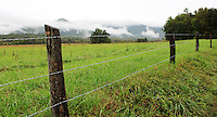 Stock photo: A panoramic view of Cades cove hills covered in clouds as seen from a fence on the loop road in the great smoky mountain national park.