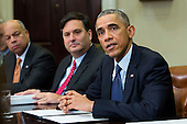 From left, Jeh Johnson, Secretary of Homeland Security, Ron Klain, Ebola Response Coordinator, look on as United States President Barack Obama speaks to the media during a meeting with his national security and public health teams concerning the government's Ebola response, in the Roosevelt Room of the White House, on November 18, 2014, in Washington, DC.  President Obama called on Congress to approve $6.2 billion in emergency spending to fight Ebola in West Africa.  <br /> Credit: Drew Angerer / Pool via CNP