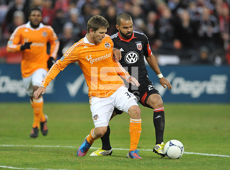 Houston Dynamo defender Bobby Boswell (32) goes against D.C. United forward Maicon Santos (29) D.C. United tied The Houston Dynamo 1-1 but lost in the overall score 4-2 in the second leg of the Eastern Conference Championship at RFK Stadium, Sunday November 18, 2012.
