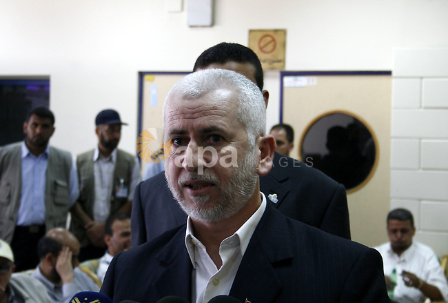 Palestinian former interior minister Said Siam speaks to the press at the Rafah border terminal crossing between the southern Gaza Strip and Egypt.  A Hamas delegation is due in Cairo for talks on a fragile three-week-old Gaza truce as Israel said it would reopen its borders with the territory at the Egyptian mediator's request.
