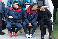 (L-R) Coaches Joao Mario, Bruno Lage and Swansea manager Carlos Carvalhal sit on the bench during the Premier League match between Brighton and Hove Albion and Swansea City and at the Amex Stadium, Brighton, England, UK. Saturday 24 February 2018