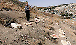 A Palestinian man walks on a land ready to be confiscated by israel authority as a cemetery for jewish in silwan  Jerusalem's old city on May 23, 2012. Photo by Mahfouz Abu Turk