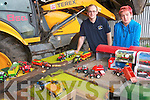 Kilmoyley farmer John Collins and Pierce Claffey pictured with some of the model farm machinery collectors items which will on sale at Kilmoyley Community Centre nest week.