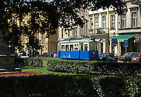 "Old classic tram in Cracow, next to the park called ""planty"". Cracow, Poland, Europe"