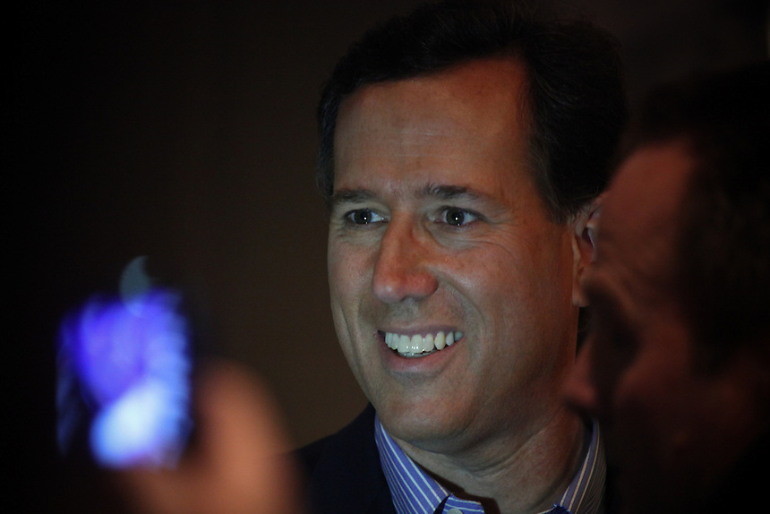 Republican presidential candidate Rick Santorum takes photos with  supporters at New Life Assembly Church in Spokane Valley, Washington on March 1, 2012.