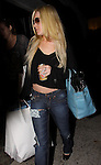 10-18-09   8PM SUNDAY NIGHT ..LINDSAY LOHAN CARRYING A BIG BLUE PURSE WHILE LEAVING THE ANDY LECOMPTE HAIR SALON IN WEST HOLLYWOOD.  LINDSAY WENT SHOPPING INSIDE THE SALON & WAS DRINKING AN A&W CREAM SODA. LINDSAY HAD RIPPED JEANS ON WITH HER POCKET COMING THROUGH. Lindsay's black nail polish was pealing off it looked pretty ghetto. ...ABILITYFILMS@YAHOO.COM.805-427-3519.www.AbilityFilms.com.