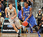 SIOUX FALLS, SD - MARCH 10:  Luis Jacobo #13 from IPFW brings the ball up court past Dante Williams #2 from Oakland in the second half of their quarterfinal game Sunday night at the 2013 Summit League Basketball Tournament in Sioux Falls, SD.  (Photo by Dave Eggen/Inertia)