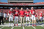 Wisconsin Badgers Honorary Captain, Pat Richter, center with captains D'Cota Dixon (14), Alec James (57), Natrell Jamerson (12) and Troy Fumagalli (81) during an NCAA Big Ten Conference football game against the Maryland Terrapins Saturday, October 21, 2017, in Madison, Wis. The Badgers won 38-13. (Photo by David Stluka)