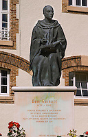A statue in the court yard of Dom Ruinart (1657-1709) writing in a book with a bird quill feather pen, who has also given his name to a prestige cuvee, Champagne Ruinart, Reims, Champagne, Marne, Ardennes, France