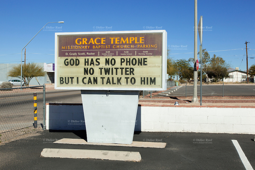 USA. Arizona state. Tucson. Grace Temple. Missionary Baptist Church Parking. A billboard with the witten words: God has no phone, no twitter, but I can talk to him. 30.01.16 © 2016 Didier Ruef
