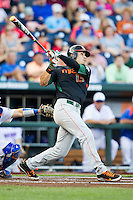 Miami Hurricanes outfielder Willie Abreu (13) swings the bat against the Florida Gators in the NCAA College World Series on June 13, 2015 at TD Ameritrade Park in Omaha, Nebraska. Florida defeated Miami 15-3. (Andrew Woolley/Four Seam Images)